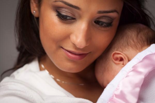 Woman Holding Her Newborn Baby.