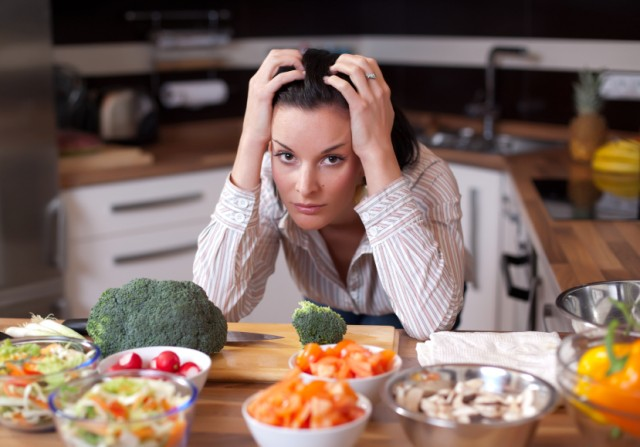 Depressed and sad woman in kitchen