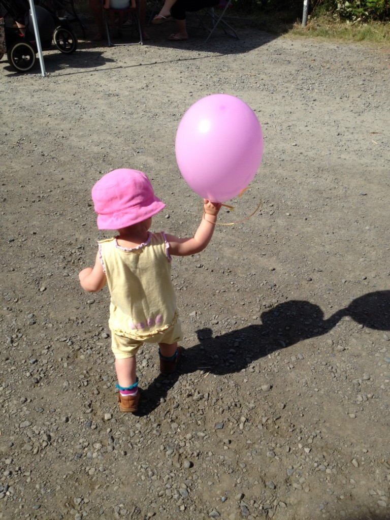 baby with pink balloon