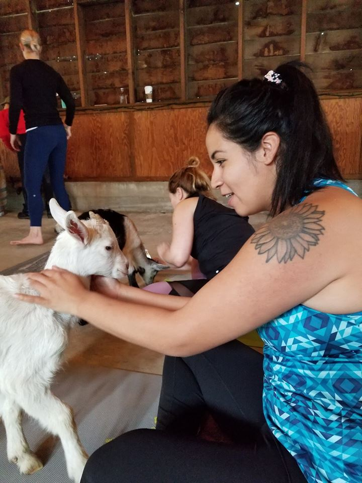 Woman petting goat
