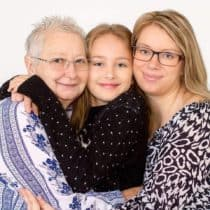 Ashley hugging her grandmother and daughter