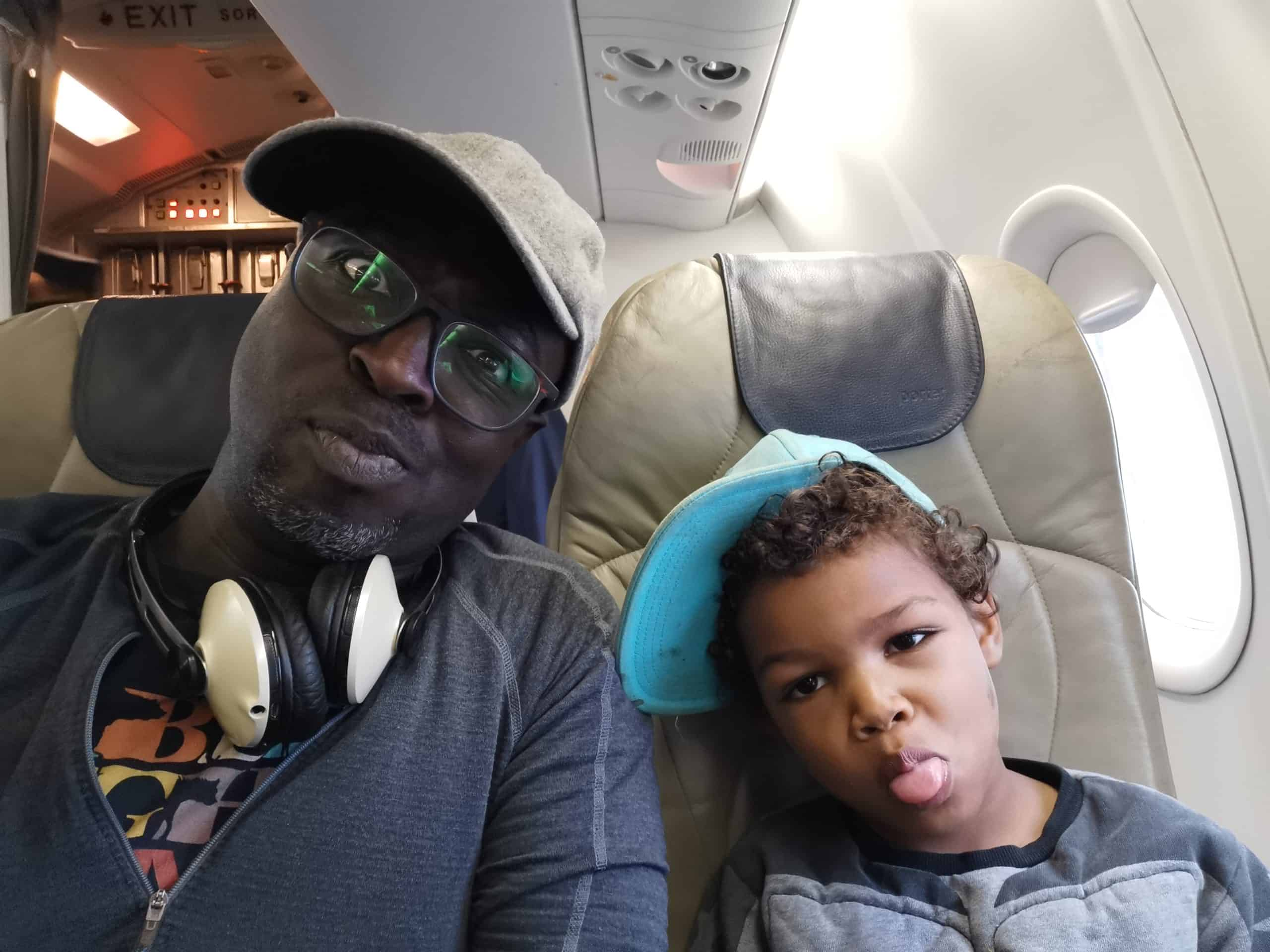 Casey and his son on a plane