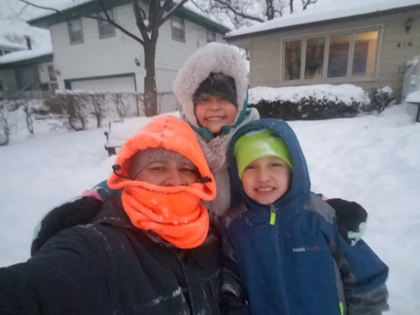 Jo posing with children in winter