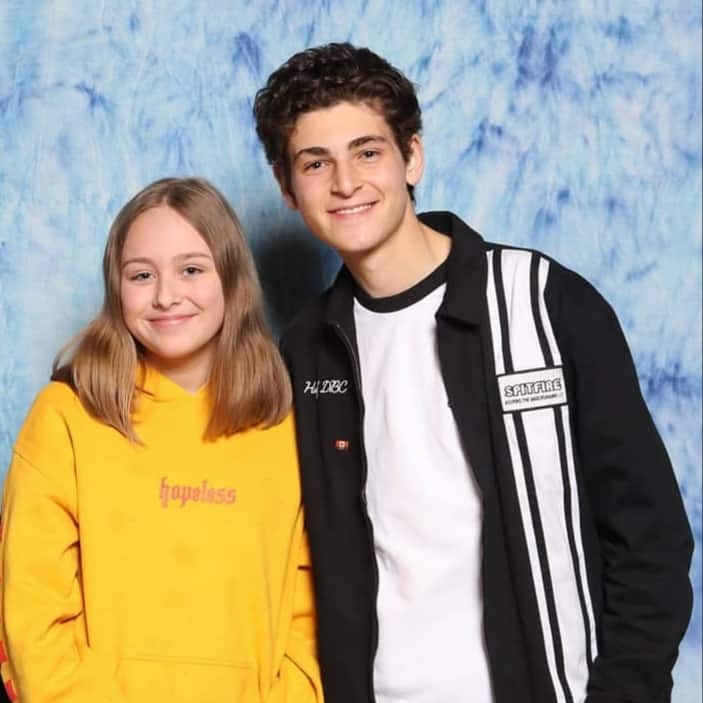 Girl and David Mazouz posting for picture