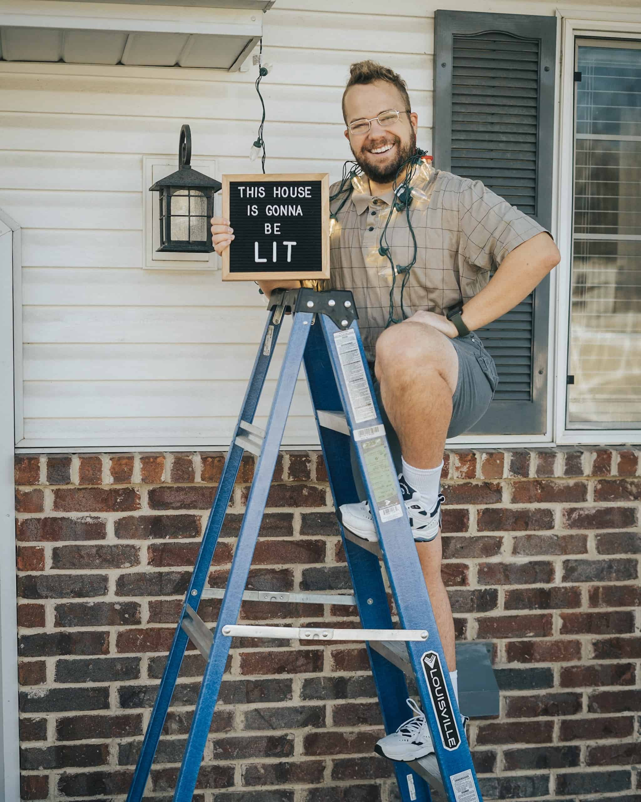 Andrew standing on a ladder