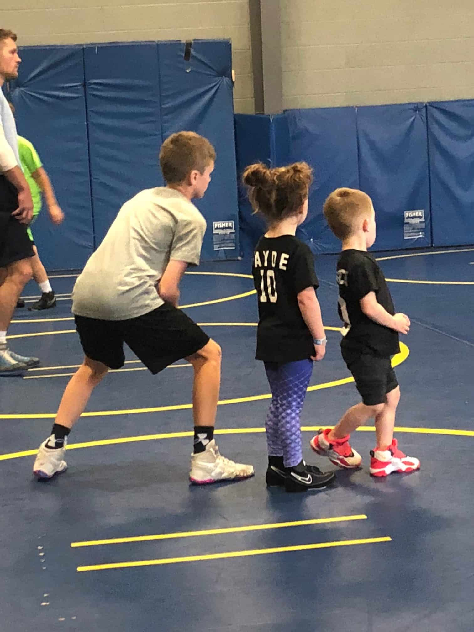 Taylor McKinney's children playing in a gym