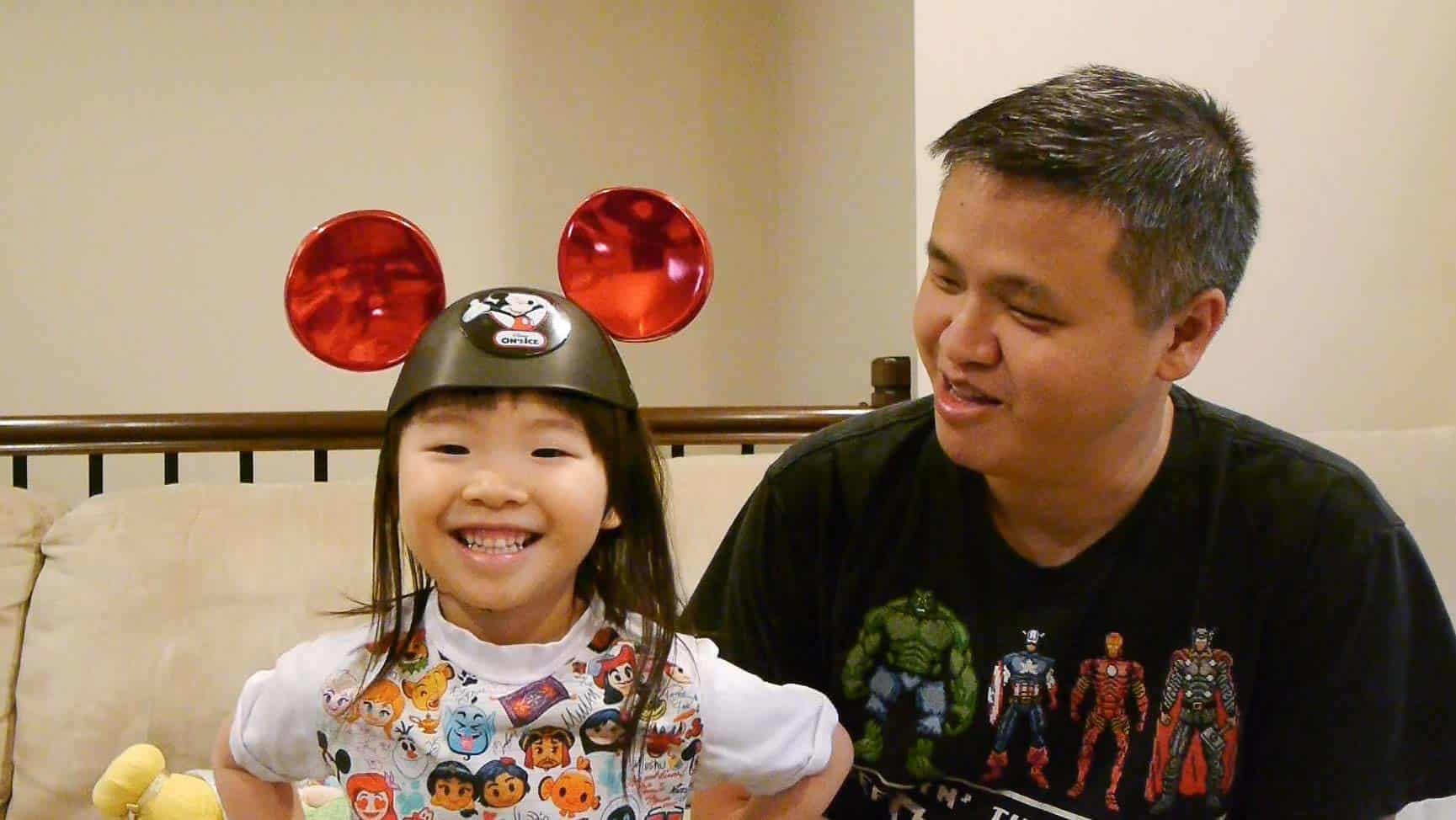 Michael and his daughter wearing Mickey Mouse ears