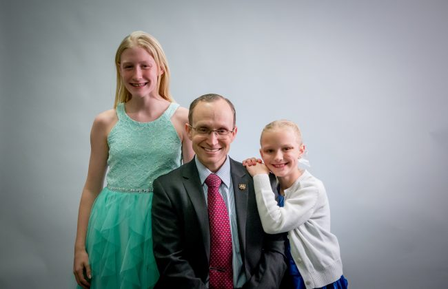 Christopher Lewis and his daughters