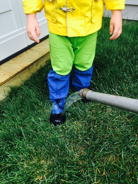 Testing our boots with the garden hose!